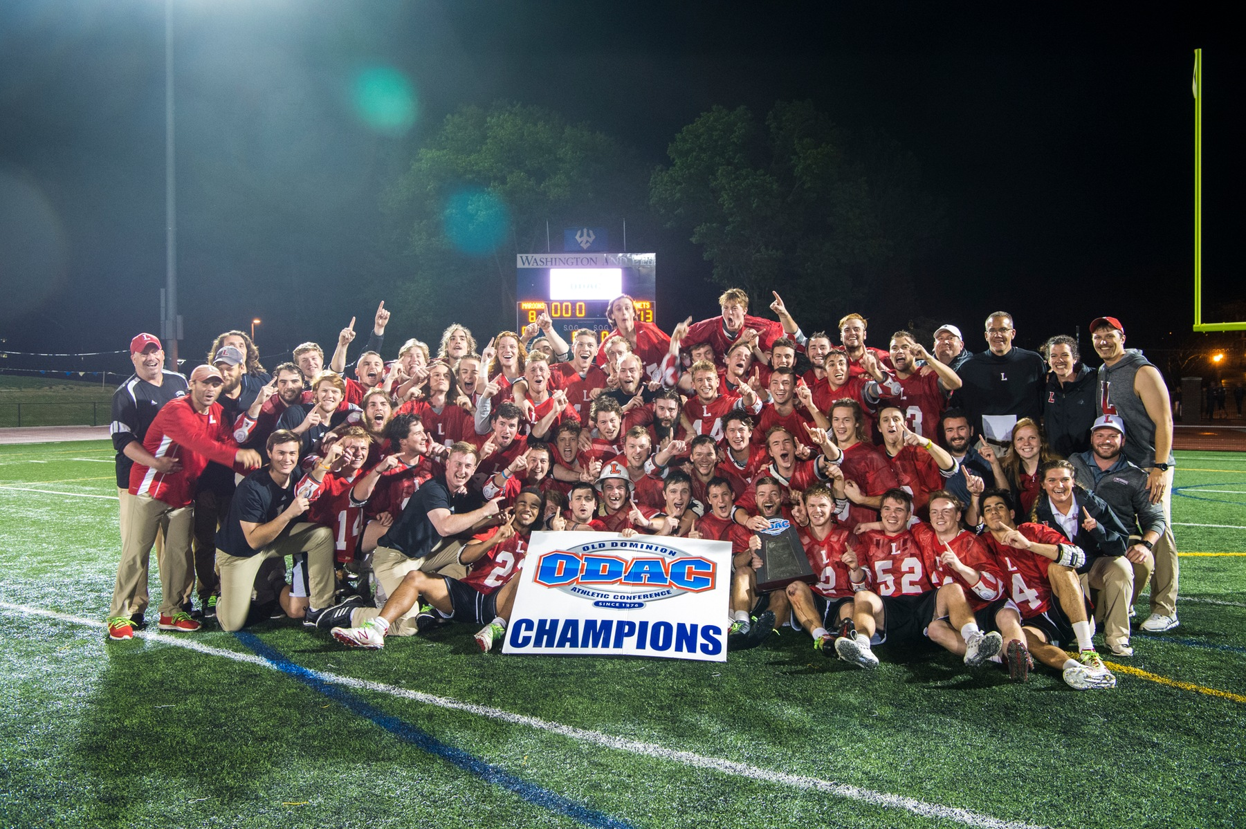 Lynchburg men's lacrosse team poses after winning the ODAC championship
