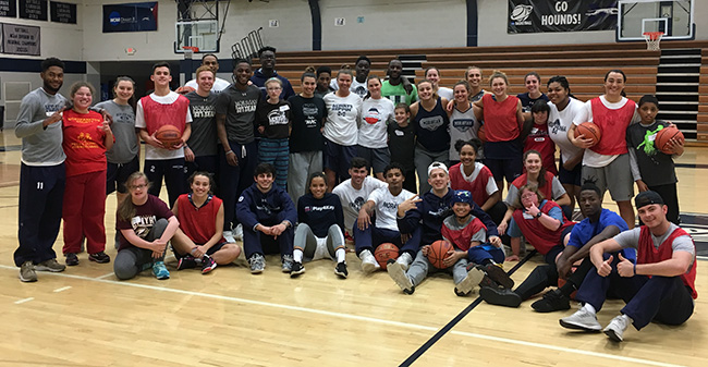 Members of the Moravian College men's and women's basketball teams with the participants of the Via Basketball Clinic.