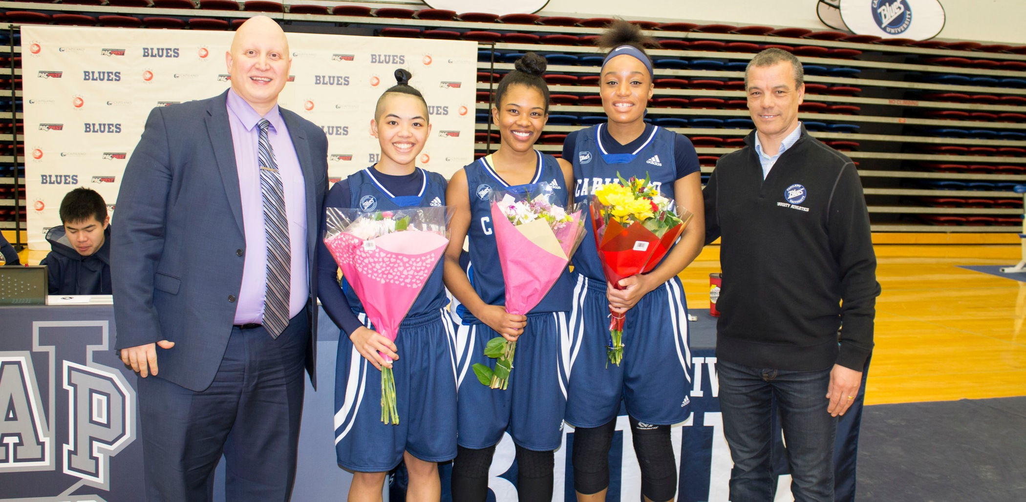 (L-R): Head Coach Ramin Sadaghiani, Ashley dela Cruz Yip, Francis Penafiel, Carmelle M'Bikata, Athletic Director Milt Williams. Photo Chris Raeside / Capilano University