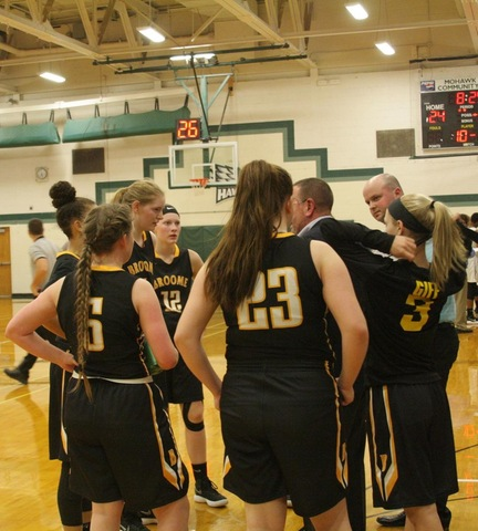 SUNY Broome women's basketball team during a timeout against Mohawk Valley