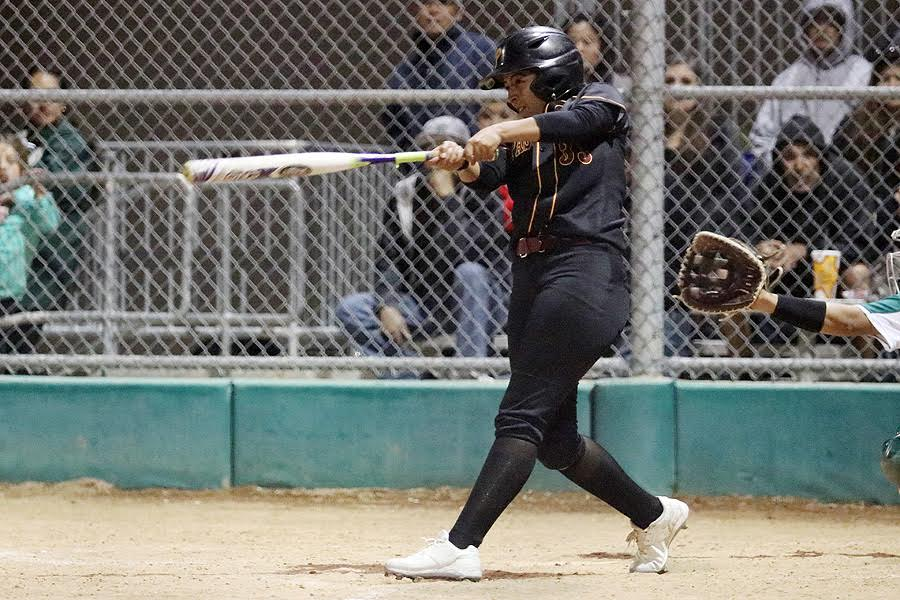 Lancer Brittany Gonzales finishes her 3-RBI double swing at East Los Angeles College Thursday night, photo by Richard Quinton.