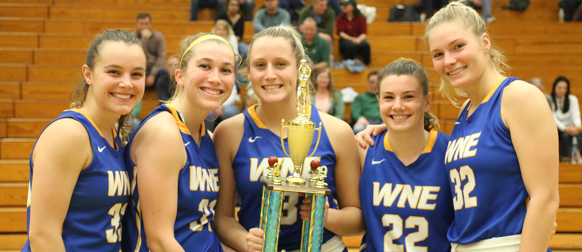 Western New England seniors (from left) Sydney Fisher, Meghan Orbann, Alyssa Stefanelli, Emily Farrell and Courtney Carlson after defeating Babson in the Lafrance Hospitality Tournament championship game on Sunday.