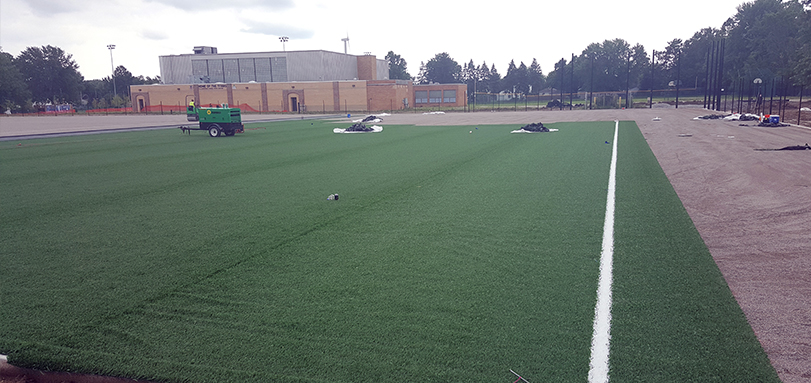 Turf Being Installed at New All-Turf Softball Complex