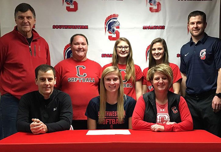 Sitting (L to R) – Jason Rice, Saige's father; Saige Rice; and Shantelle Rice, Saige's mother. Standing – Mike McCabe, Creston High School head softball coach; Teri Keeler, Creston High School assistant softball coach; Tristen Rice, Saige's sister; Peyton Rice, Saige's sister; and Nick Weinmeister, Southwestern head softball coach.