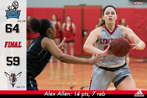 Alex Allen passes the basketball.
