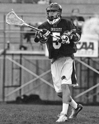Black and white action photo of Kevin Lally playing lacrosse