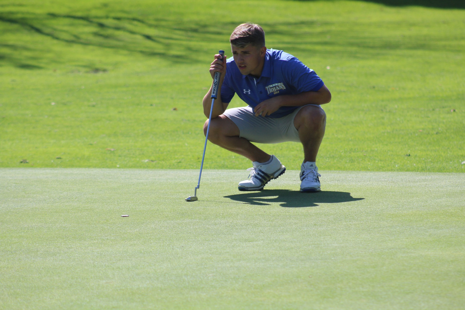 Jackson Hamlin lines up a putt at the NIACC Invitational on Monday at the Mason City Country Club.