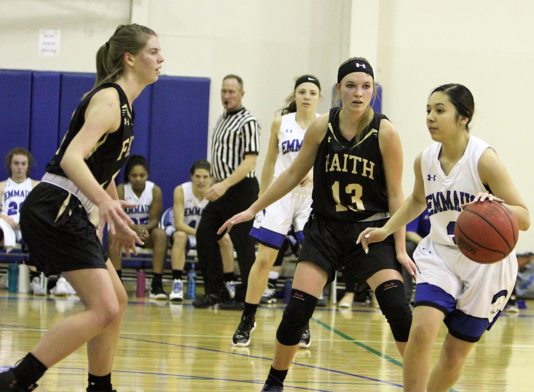 Bekah Smith and Mackenzie Hanson guard an Emmaus player in a 64-23 loss on the road.