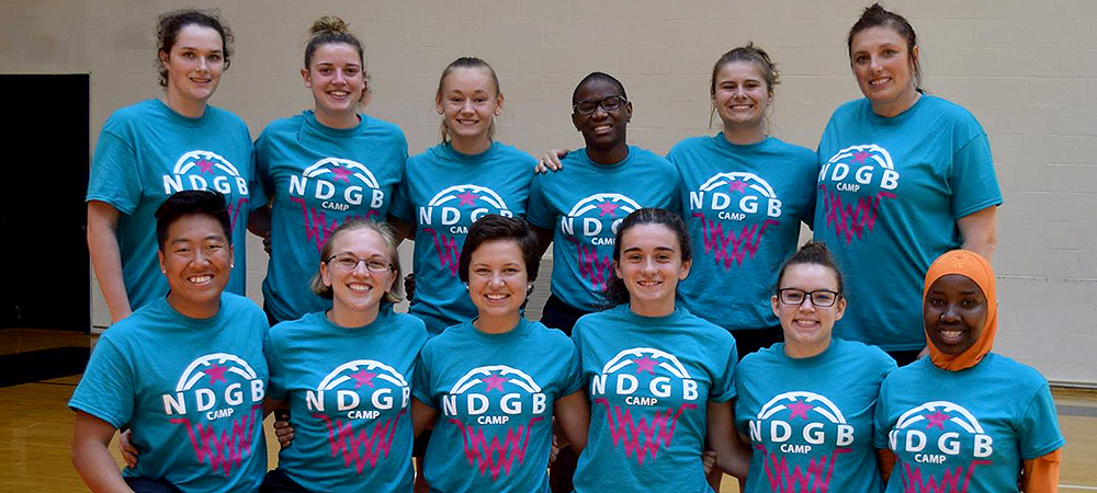 Members of Gallaudet's women's basketball program pose for a group photo at the 2018 National Deaf Girls Basketball Camp in Frederick, Md.