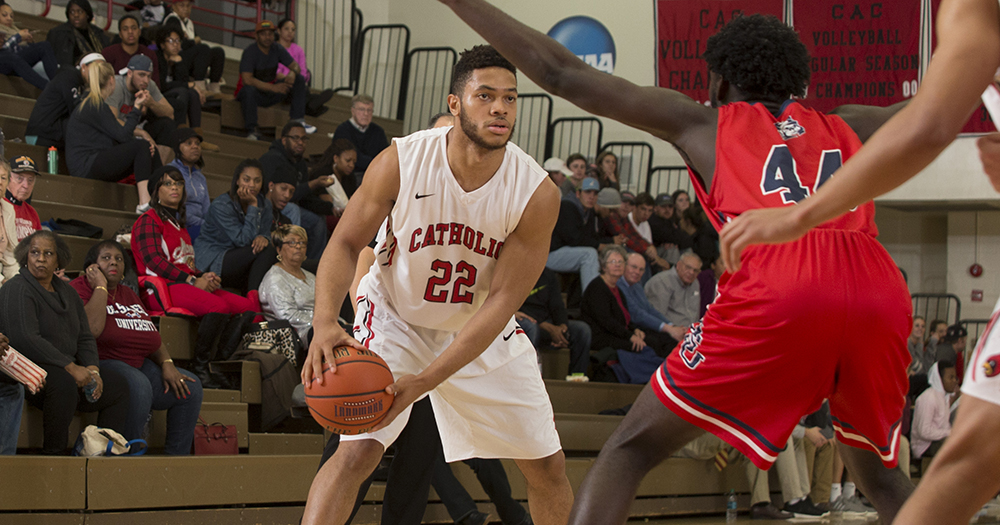 Howard Powers Catholic Past Hood, 100-82; Howes Becomes Program Wins Leader