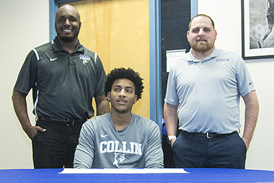 Nighael Ceaser flanked by Collin College coaches.