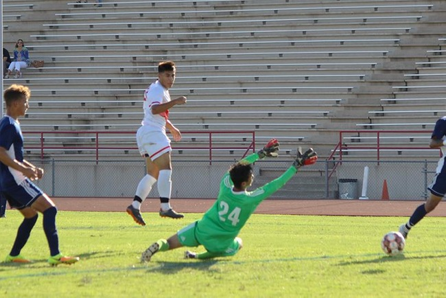 Mesa's Moses Durazo heads one into the goal over the Paradise Valley goalkeeper in Tuesday's 5-1 victory. (Photo by Aaron Webster)