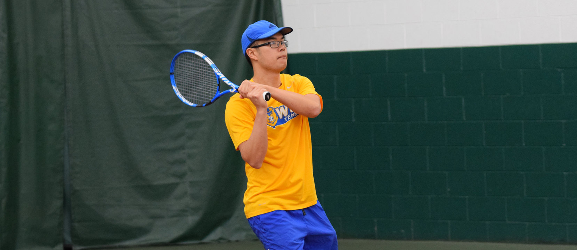 Junior Michael Tran won at No. 5 singles in Western New England's 8-1 win over Brooklyn College in Orlando on Friday. (Photo by Rachael Margossian)