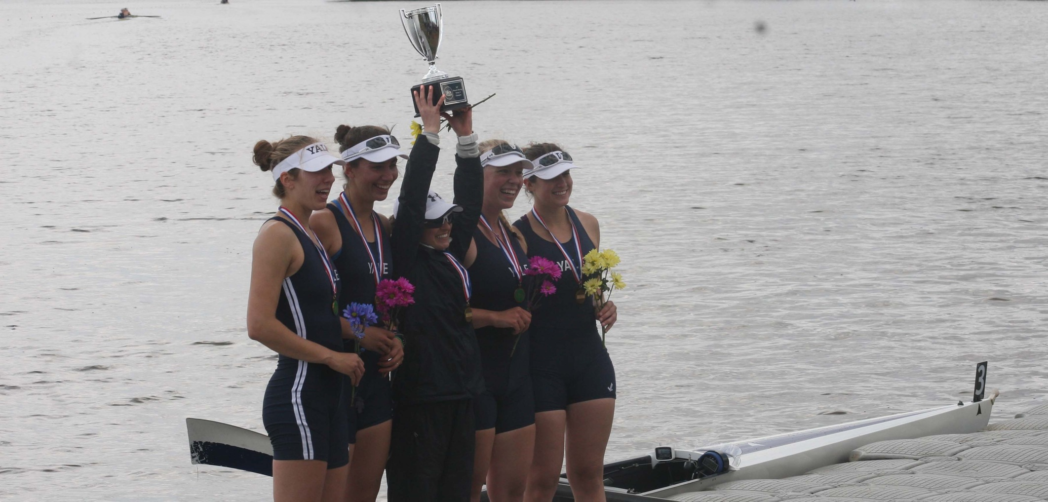 The varsity four with the Ivy League Trophy (Tim Bennett photo)
