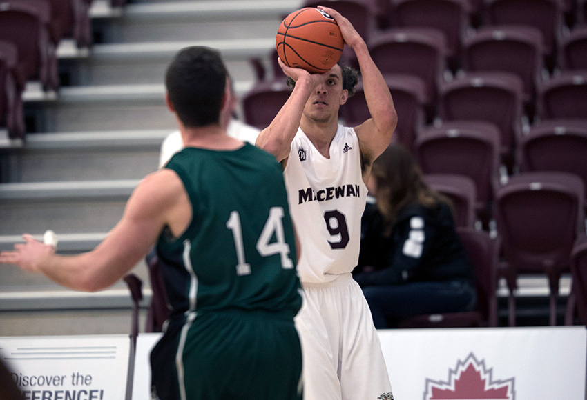 Dustin Gatzki puts up one of his four three-pointers for the MacEwan Griffins on Friday night over Saskatchewan's Sebastien Turcotte (Robert Antoniuk photo).