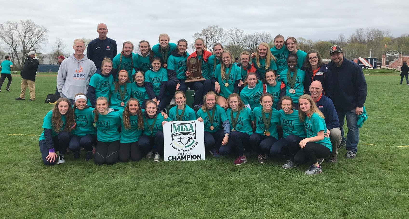 Hope women's track & field team poses with championship MIAA trophy