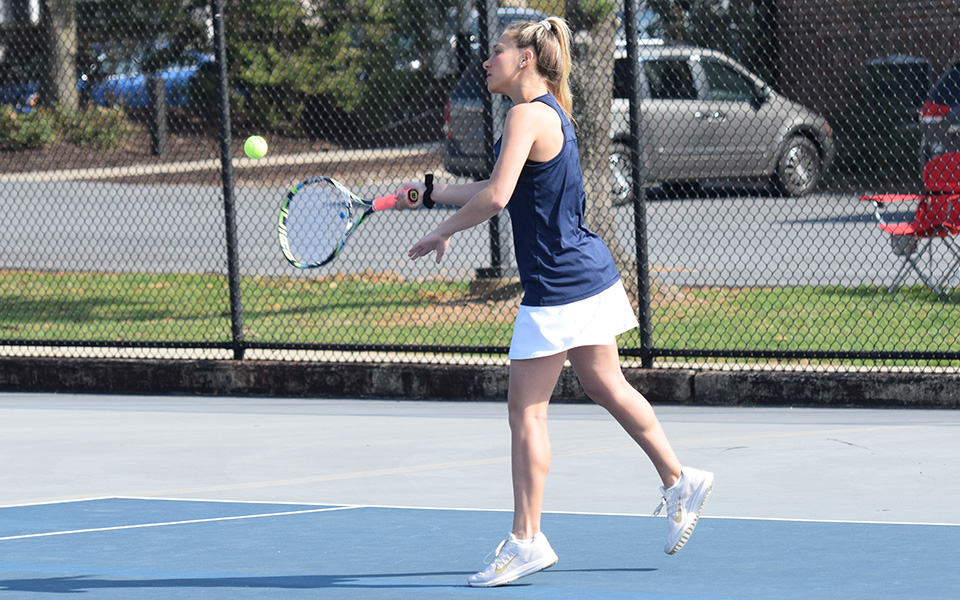 Sophomore Brooke Adams returns a shot during singles action versus Neumann University at Hoffman Courts.
