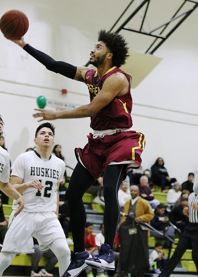 Todd Barnes goes up for a layup as part of his 30 points in the Lancers season finale Friday night at East Los Angeles College, photo by Richard Quinton.