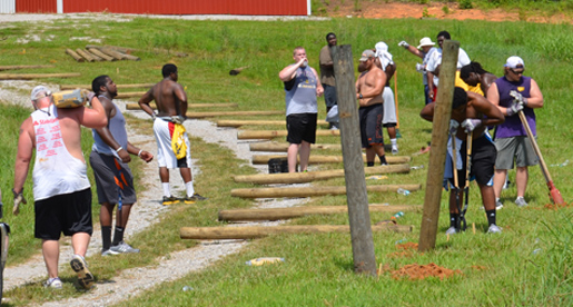 From fenceposts to painting, Tech football players help at Mustard Seed Ranch