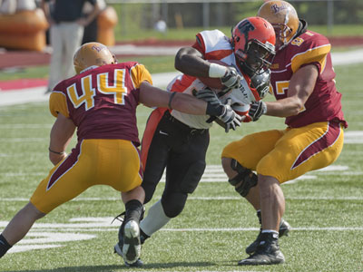 Ferris State's Matt Ryan (#44) and Muneer Bawayeh (#97) combine for a stop in Saturday's game versus Findlay (Photo by Ed Hyde)