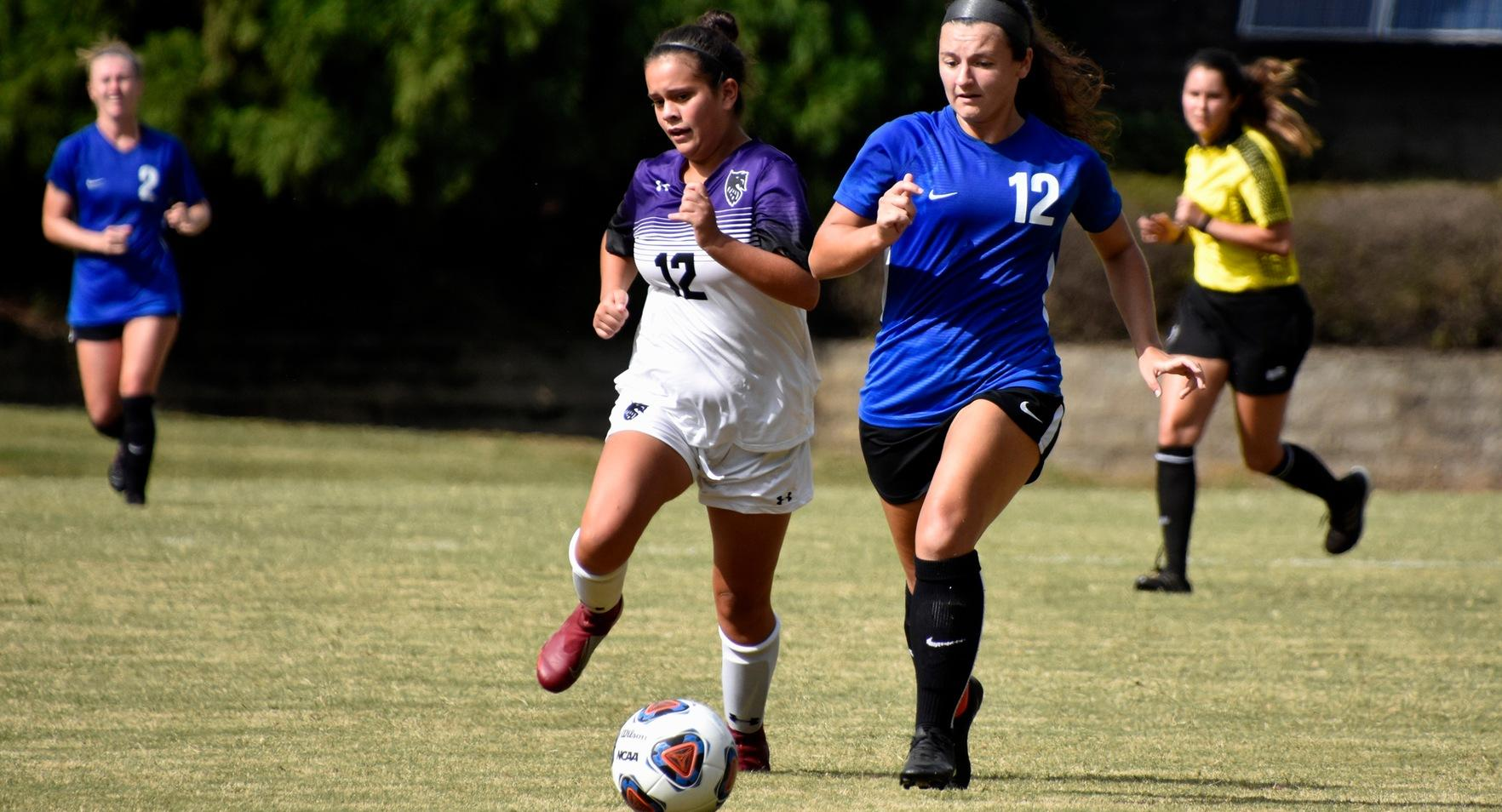 Caroline David & Megan Shina Score, Defense Shines in Victory Over Huntingdon