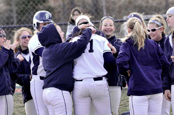 The Judges mob Melissa Nolan '14 after a home run