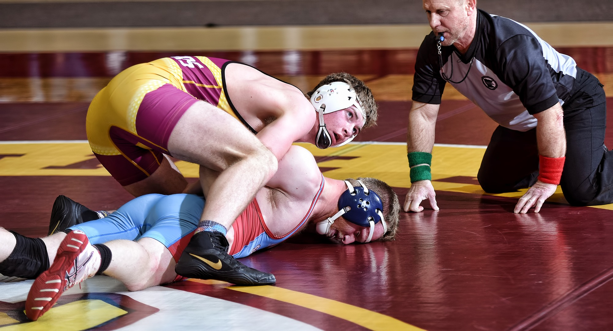 Freshman Ayden Friese gets the upper hand in his match at 184 in the Cobbers' dual with St. John's. He went on to record a 14-6 major decision and help CC beat SJU 36-12