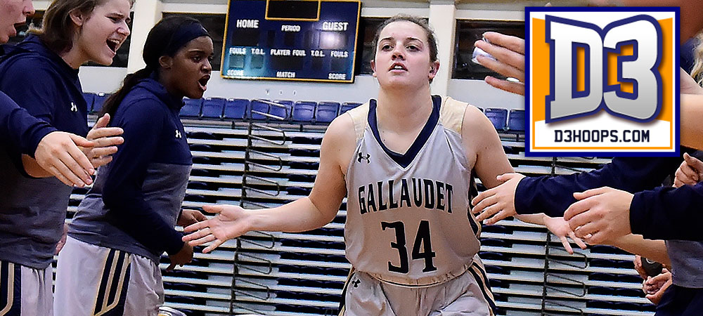 Gallaudet's Hannah Neild runs out during the starting lineups of a home game. A D3hoops.com logo is in the upper right corner. Neild slaps hands with her teammates while running out.