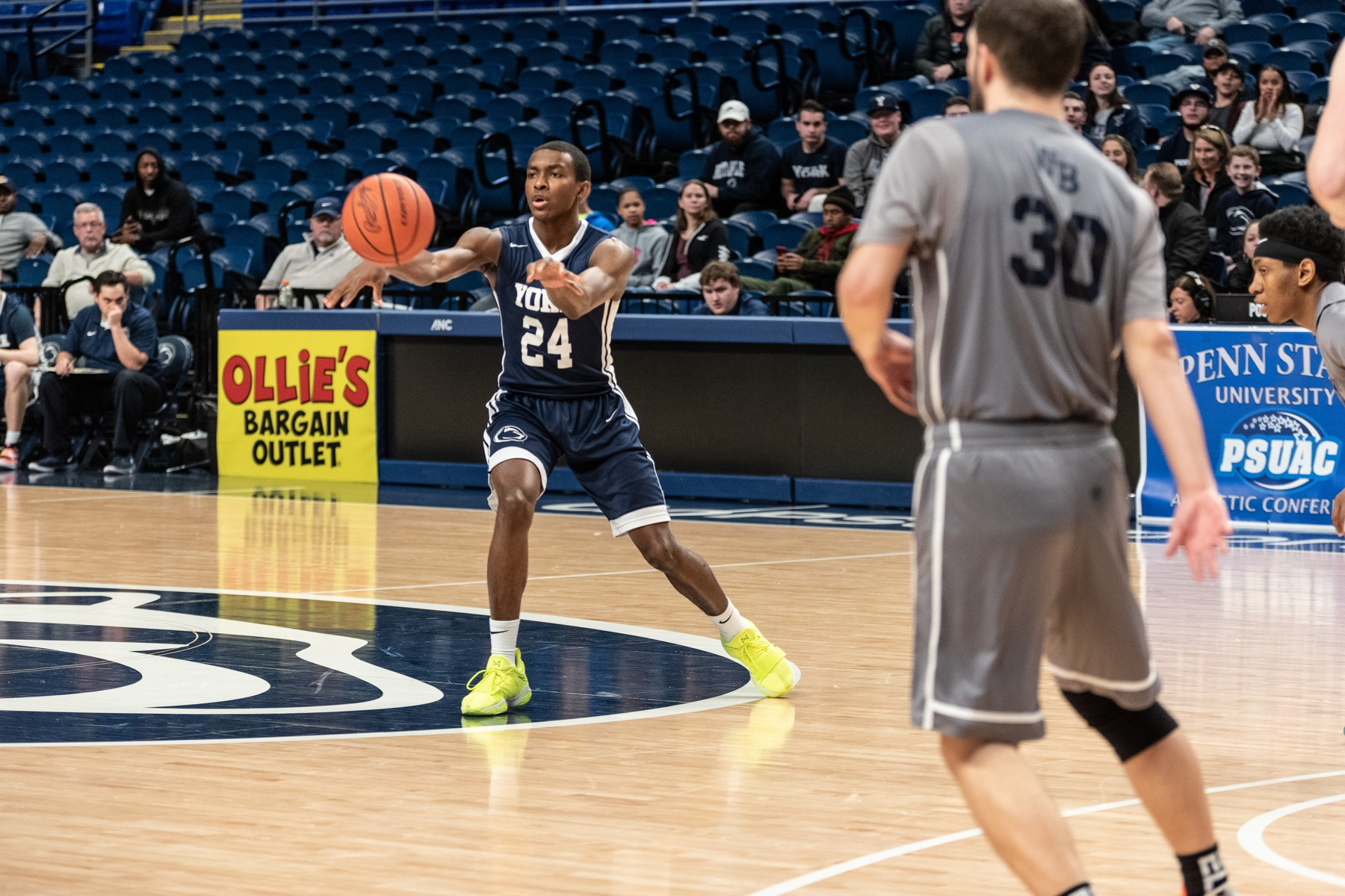 John Gillespie swings the ball around the court during the PSUAC Championship Game last weekend.