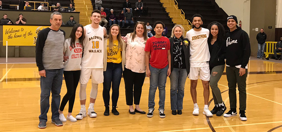 Seniors Jay Battle and Kyle Nader accompanied by family for Seniors' Night