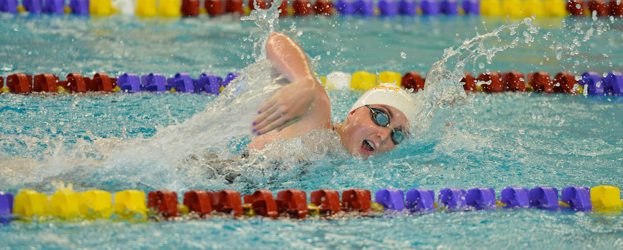 Swimming teams break records during first day at Liberal Arts Championships