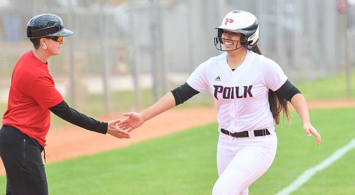 Head Coach Donna Byars congratulates Alexis McBride as she rounds third base after hitting a home run against Lake-Sumter. (Photo by Tom Hagerty, Polk State.)