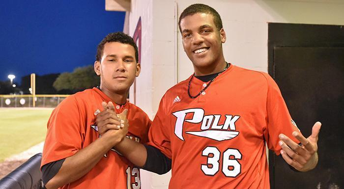 Maikor Mora and Jordan Gurrero, who were selected in this year's MLB draft, pose for a photo in the dugout during an April 8, 2015, game. (Photo by Tom Hagerty, Polk State.)