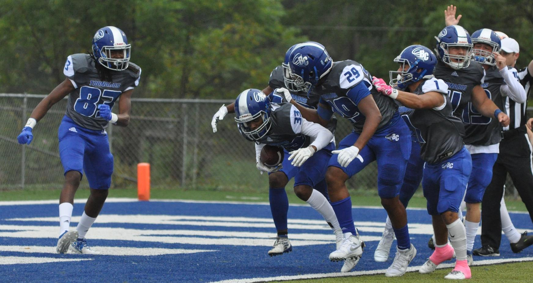 The Brevard College special teams unit celebrates a fumble recovery touchdown in Saturday's 22-10 triumph over Maryville College (Courtesy of Tommy Moss).