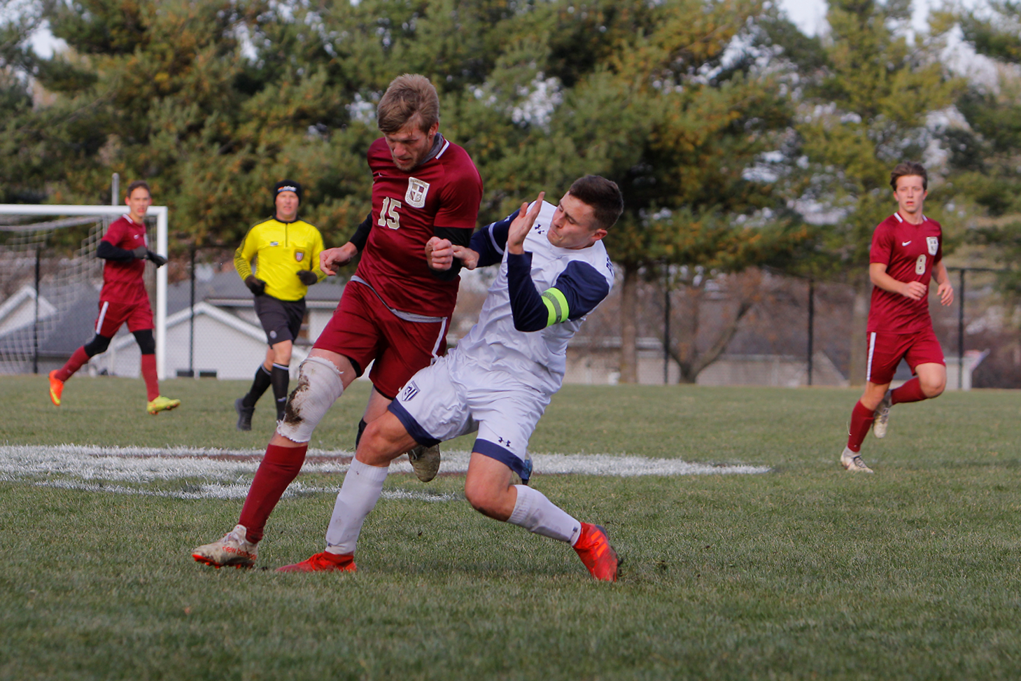 Chase Clark battles a Providence defender in his final game as a Faith Eagle