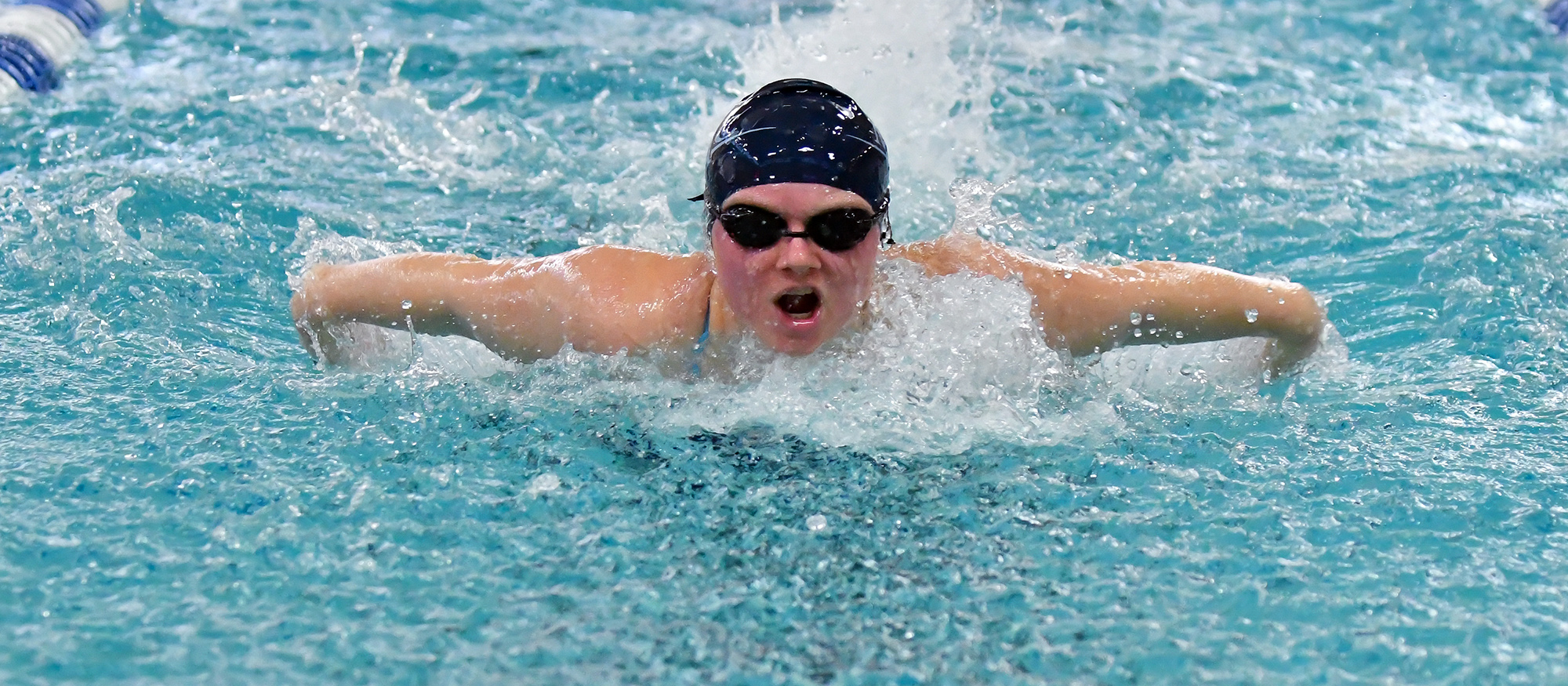 Action photo of Lyons swimmer, Ashton Bliss.