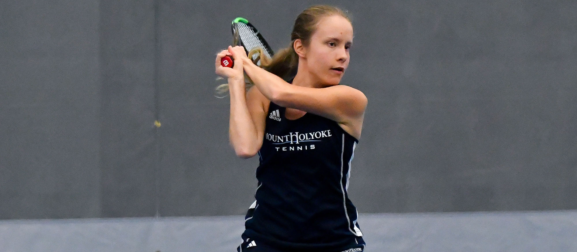 Action photo of Lyons tennis player, Anya Gerasimova.