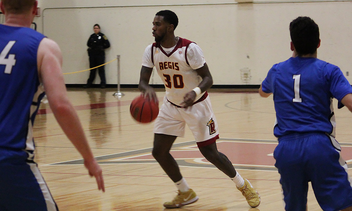 Pride Men's Hoop Holds On for GNAC Win Over Suffolk