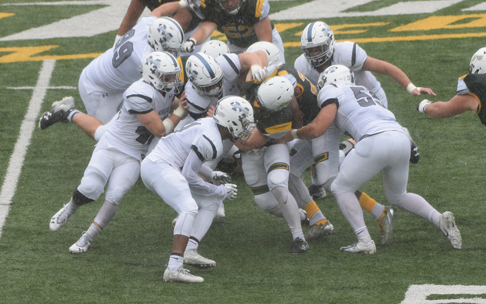 The Moravian defense makes a stop at McDaniel College during the third quarter.