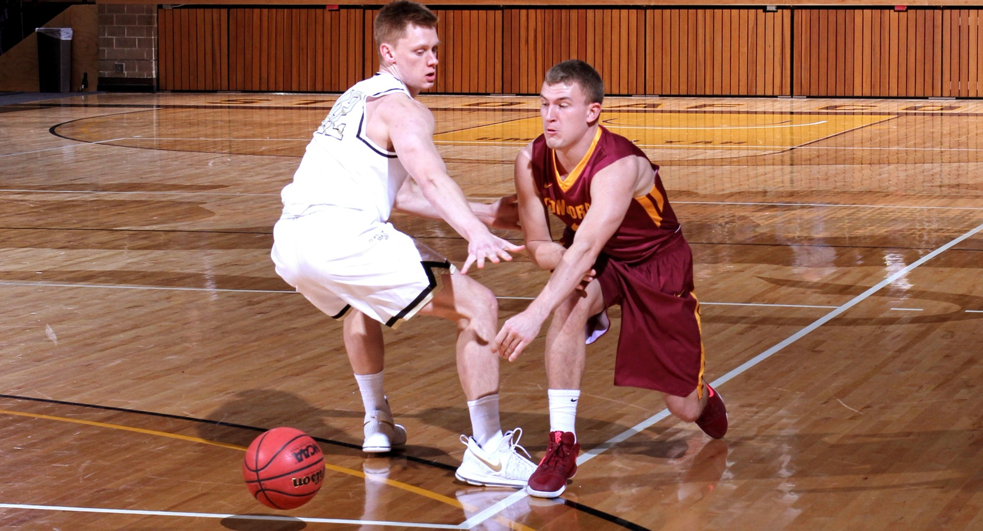 Junior Austin Rund makes an entry pass to the post during the Cobbers' game at St. Olaf. (Photo courtesy of St. Olaf Sports Information Department)