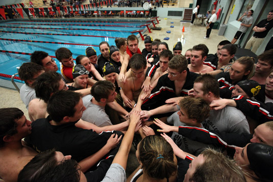 Men's and Women's Swimming starts off season with Midnight Madness