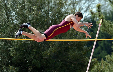 A Sea Gull track member competes in the pole vault