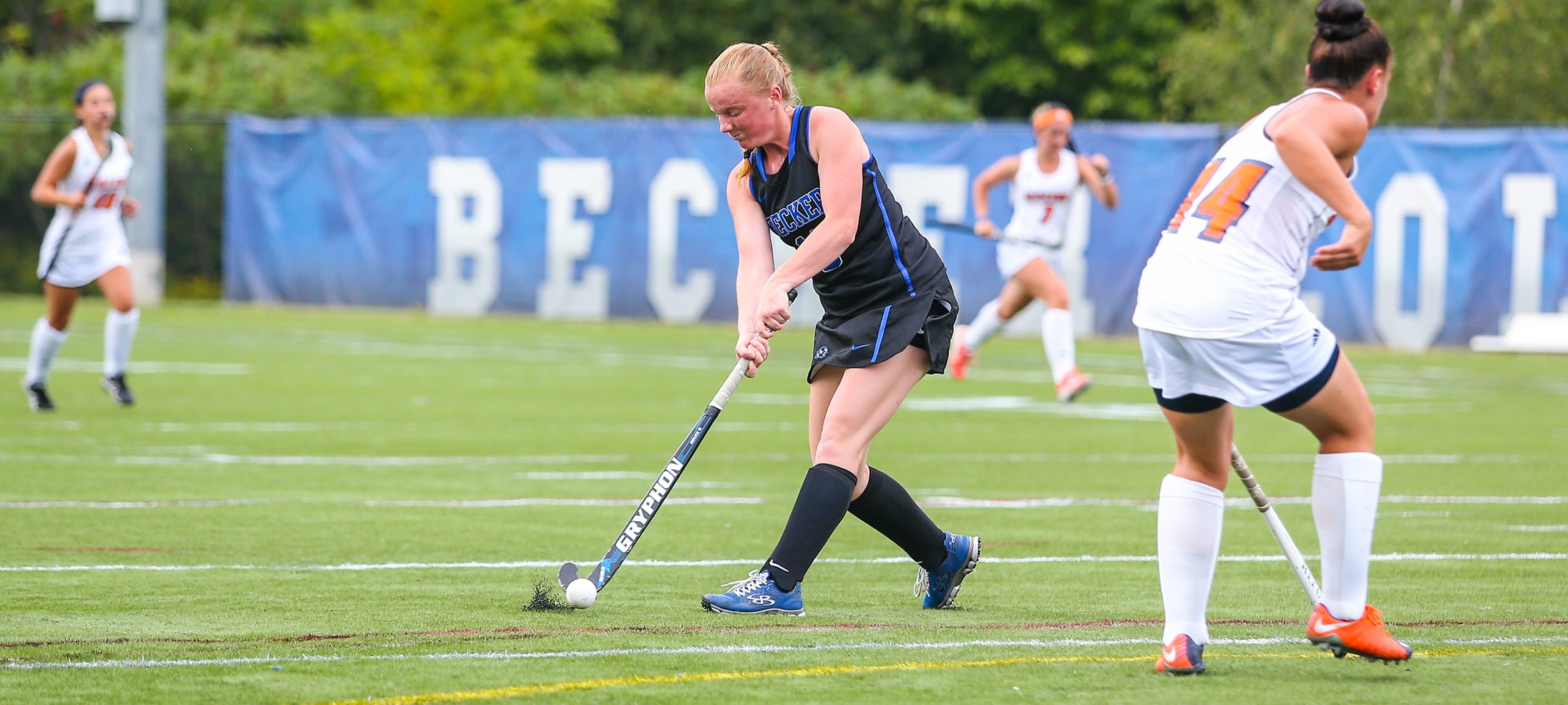 Lauren Niemann hitting the field hockey ball