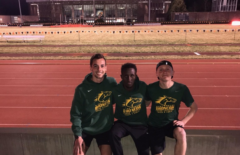 Kobie Lane, Abshir Yerow and Nick Arnecke standing in front of Princeton University's track facility.