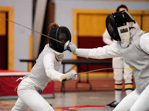 Women's fencing shines at home