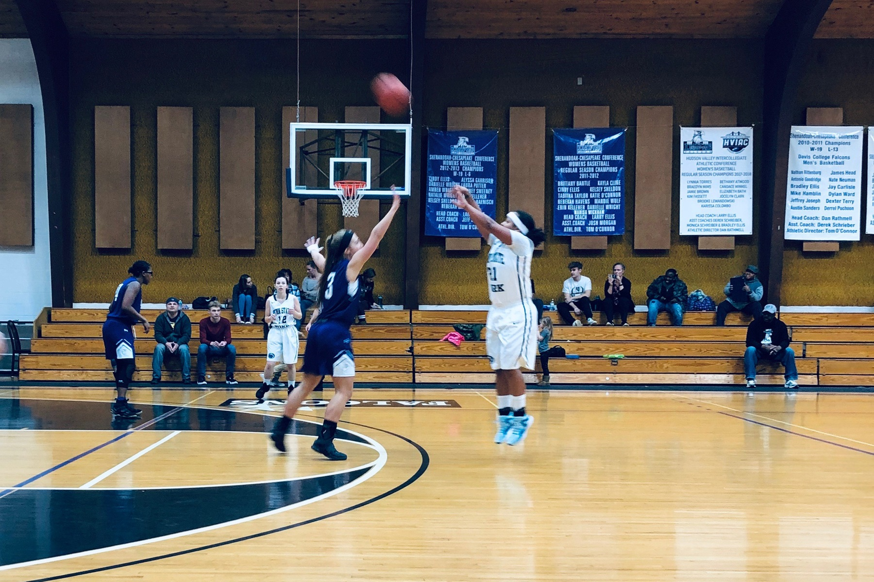Charizma Johnson shoots a three-pointer at the Davis College Tip-Off Tournament.