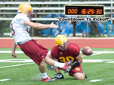 Redshirt freshman Cody Hillman kicks while sophomore Damien Miller (#80) holds at practice