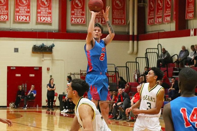 Mesa's Kyle Fischer shoots a jumper in Saturday's game against Phoenix College. (Photo by Aaron Webster)