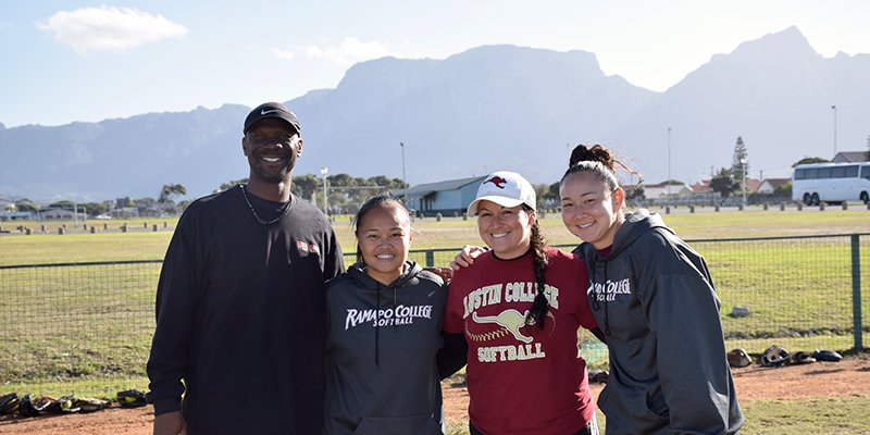 Willamette Head Coach Damian Williams with U.S. softball players in South Africa