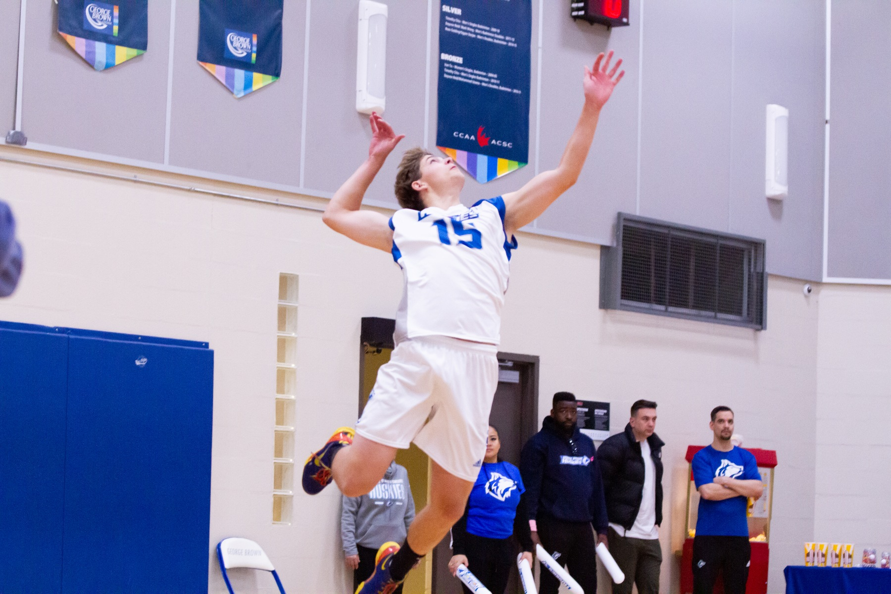 Volleyball player Grayson Engleman hits a jump-serve